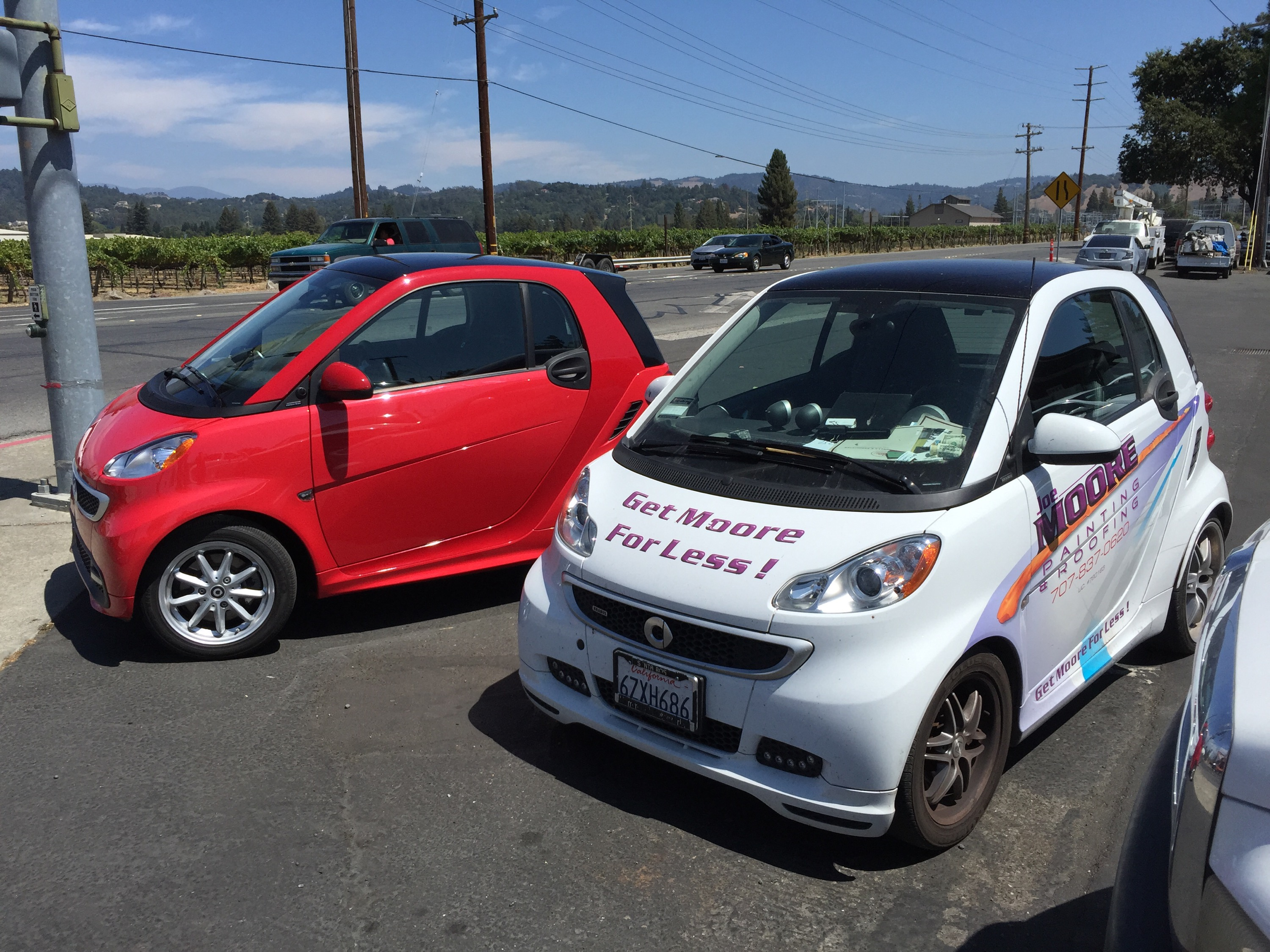 gas and electric Smart Cars parked st Sixt car rentals os Santa Rosa, California.